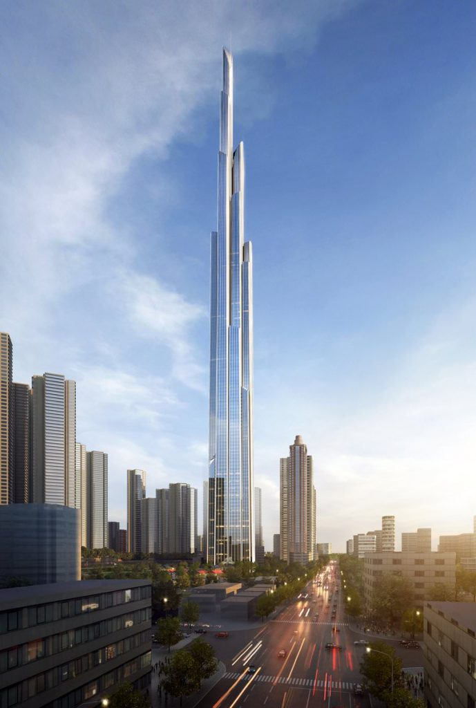 Render of a very tall glass building in the middle of a metropolis looking city. The sky is blue with some light clouds