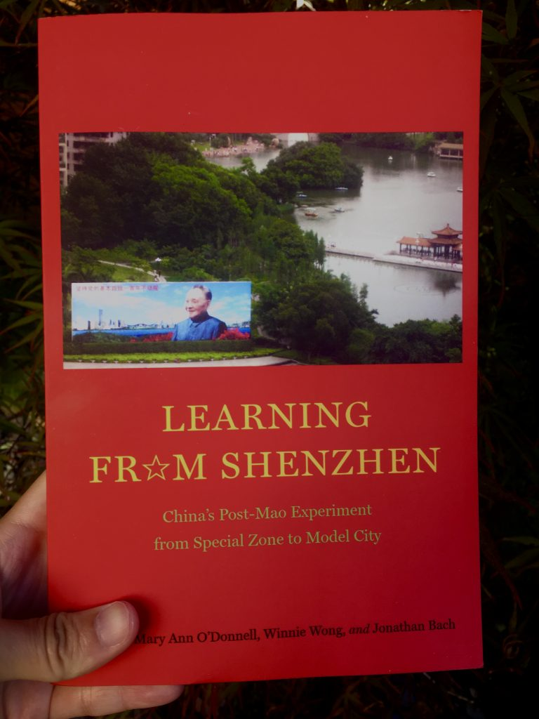 """Colour image of a red book with Deng Xiaoping on the front, book is titled; """"Learning from Shenzhen'"""