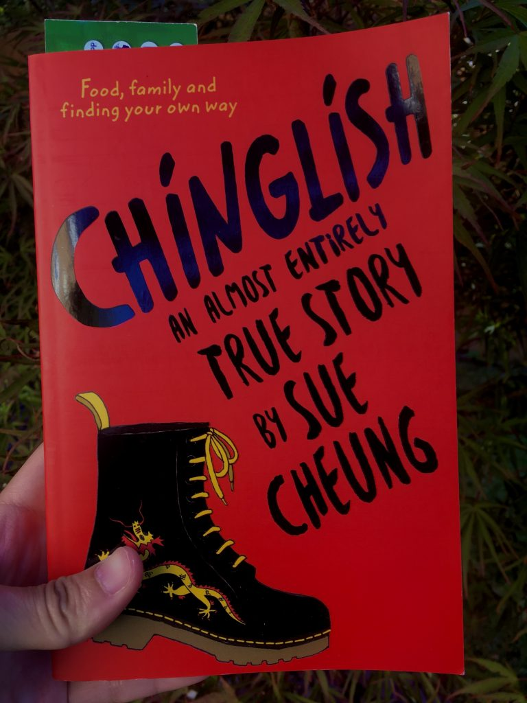 """Cover of red fiction book called, """"Chinglish an Almost Entirely True Story by Sue Cheung"""""""
