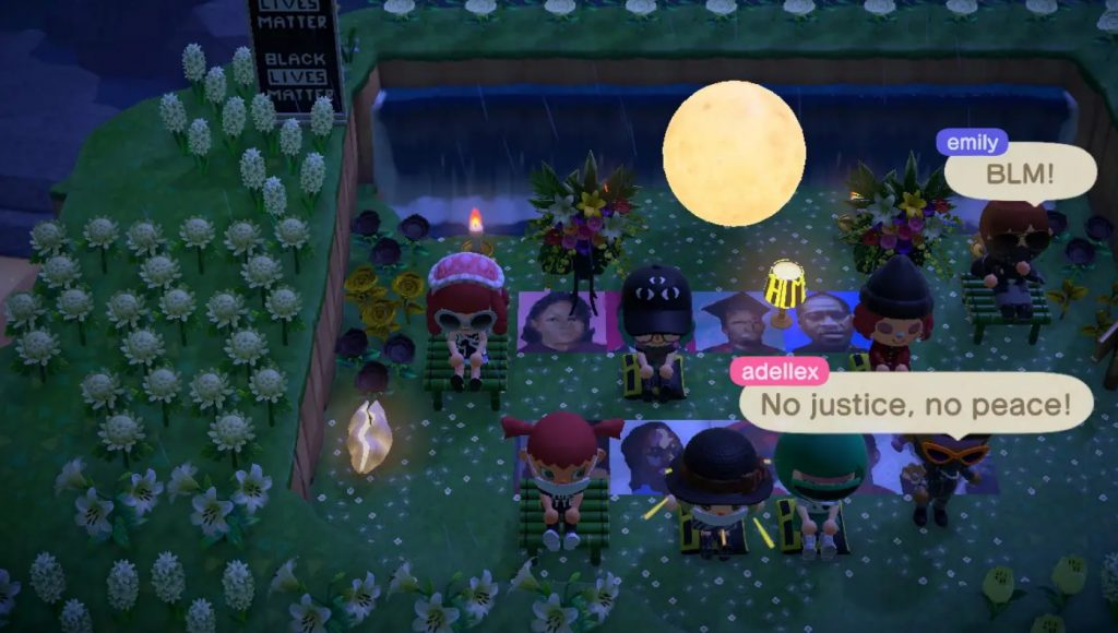 A scene from Animal Crossing where protestors sit and chant for Black Lives Matter. 7 characters are sitting in a backyard with a sign at the entrance that says Black Lives Matter. Photos of George Floyd and other victims are one the ground with small bouquets of flowers. There are 2 speech bubbles, one says 'BLM!', the other 'No justice, no peace!'.