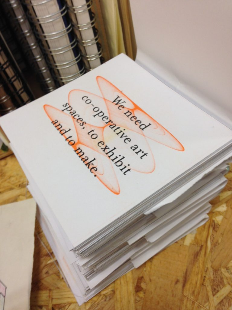 A stack of white cards printed with orange image and black text