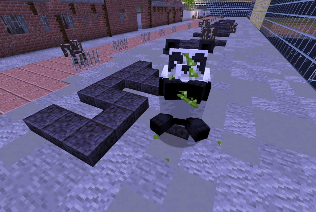 A giant panda sits on the symbol of 'power' built with black 'Polished Blackstone Slab' outside Cattle Depot. The panda is eating green bamboo greedily. A few cows can be seen scattered in the background around the other symbols, oblivious of the panda. Cattle Depot is on the left of the symbol, the glass grid structure is on the right.