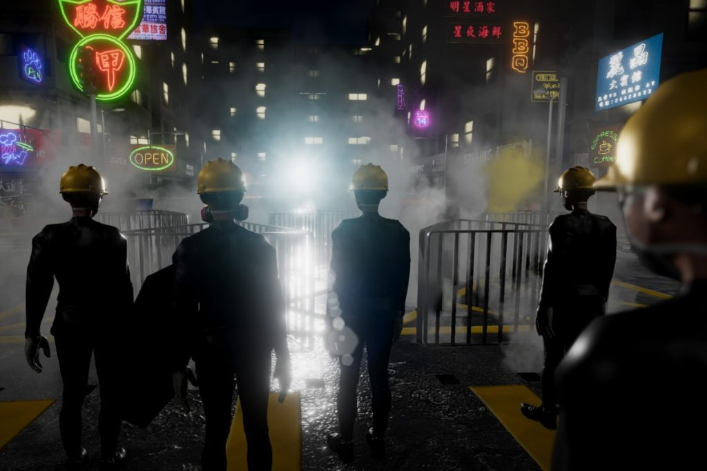 A night scene in a home-made VR game by Hong Kong activists. Protesters stand behind a barricade as police deploy tear gas. The barricade is made with metal barriers dismantled from the sidewalk. The protesters with yellow helmets and gas masks stand in the foreground  with their backs facing the audience. The barricade is in the mid-ground. The cityscape of Hong Kong with neon signs and high rises are the backdrops of this scene.