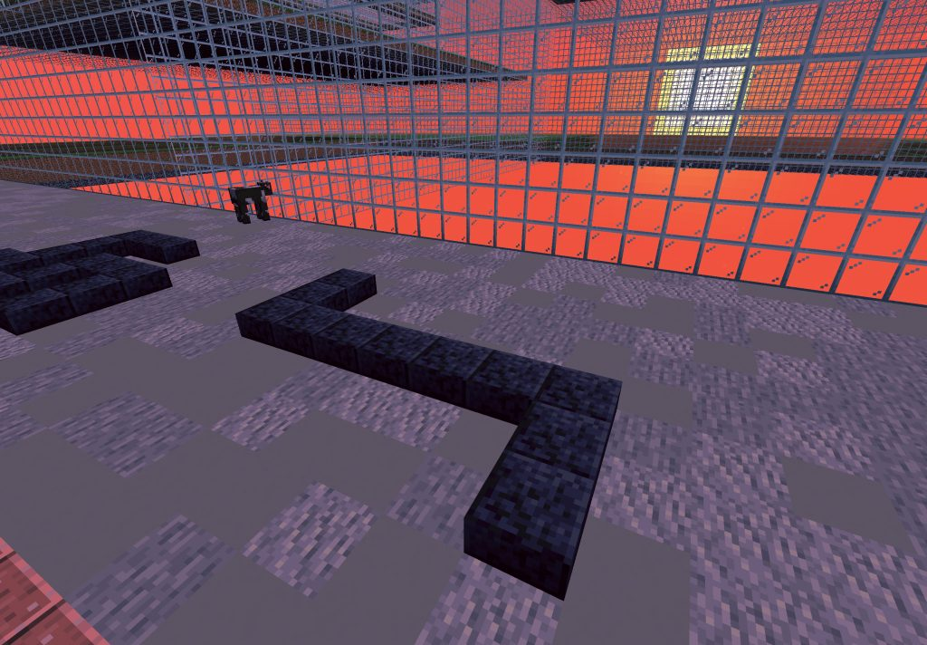 The symbol of 'negation' built with 'Polished Blackstone Slab' is seen against a setting sun in a red sky. Cattle Depot is tinted in red. A cow is in the far background watching the sunset behind the glass grid.