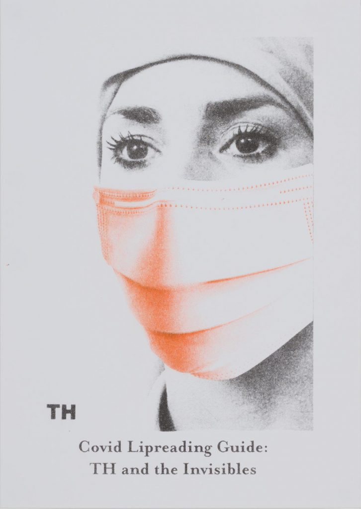 Black and white portrait of a woman's face, her nose and mouth covered by a mask printed in orange, with black text below.