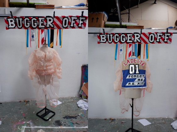 """Another split screen image of the mannequins. Both images have the Bugger Off banner above. On the left we are looking slightly down on the torso, which gives the fleshy mesh muscles different context, shape and shadows as they react to the studio lighting. On the right we get to see the back of the bib. Ladette is written in red across the shoulders. Just like a sports jersey, the numbers zero and one occupy the back but glisten in silver. Beneath the words, """"forgot me p.e. kit"""" are swiftly about to run off the side of the bib."""