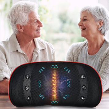 Two older people sat at a table facing each other visible from the waist up, they are smiling and looking happy. In the foreground on the table is a round disc like piece of equipment. It's black with a golden spine glowing centrally and wavy blue lines around it as well as 3 buttons either side on both sides.
