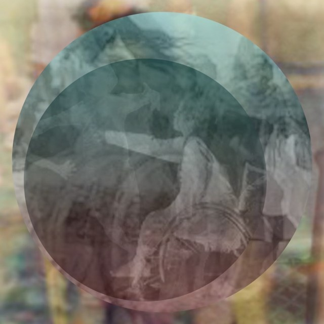 a mottled image of Nadine in a wheelchair sat upright, seen sideways her left arm on the wheel her right arm extended and indecipherable images of people around her in circles and shades of salmon and aquamarine