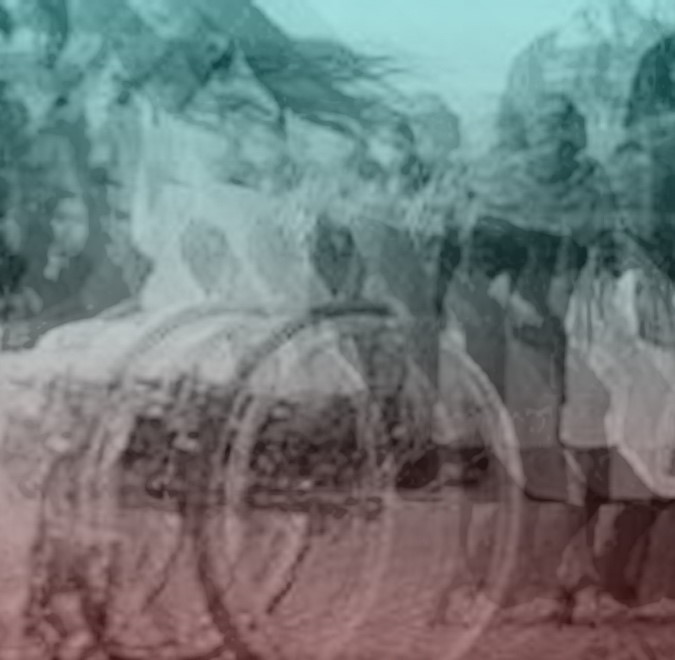a mottled light blue dusky brown unclear image of Nadine in motion. Her wheels replicated and vibrating. Her hair blowing in the breeze.