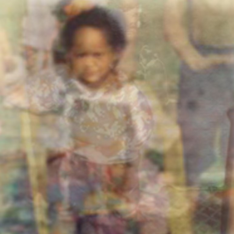 Close up of the child sat on a yellow chair facing forward